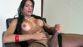 Free Jo Garcia HD porn videos Tanned brownish hair tranny Jo Garcia with tits make up among the midst of fish net pantyhose enjoys playing with her long intense dick on chair among the midst of