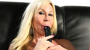 Free Erica Lauren HD porn videos Attractive lady Erica Lauren lies on the couch and satisfies her needs with a dildo
